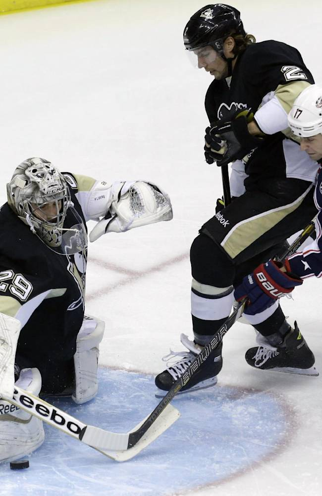 Pittsburgh Penguins goalie Marc-Andre Fleury (29) stops a shot by Columbus Blue Jackets' Brandon Dubinsky (17) with help from Penguins' Matt Niskanen (2) and Kris Letang (58) in the first period of an NHL hockey game in Pittsburgh on Friday, Nov. 1, 2013