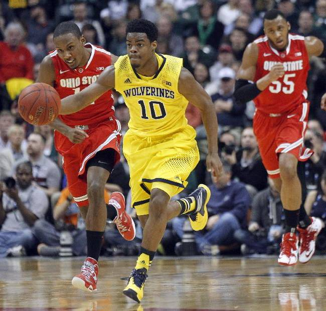 Michigan guard Derrick Walton Jr. (10) drives the ball in the second half of an NCAA college basketball game against Ohio State in the semifinals of the Big Ten Conference tournament Saturday, March 15, 2014, in Indianapolis. Michigan won 72-69