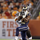 St. Louis Rams wide receiver Kenny Britt, right, makes a catch against Cleveland Browns cornerback Justin Gilbert in the first quarter of a preseason NFL football game Saturday, Aug. 23, 2014, in Cleveland The Associated Press