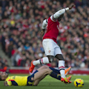 Arsenal's Bacary Sagna, controls the ball in front of Sunderland's Fabio Borini, during their English Premier League soccer match, at Emirates Stadium, in London, Saturday, Feb. 22, 2014