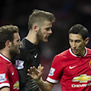 Manchester United's Angel Di Maria, right, congratulates teammates Juan Mata, left, and goalkeeper David De Gea after their 3-1 win during the English Premier League soccer match between Manchester United and Leicester at Old Trafford Stadium, Manchester,