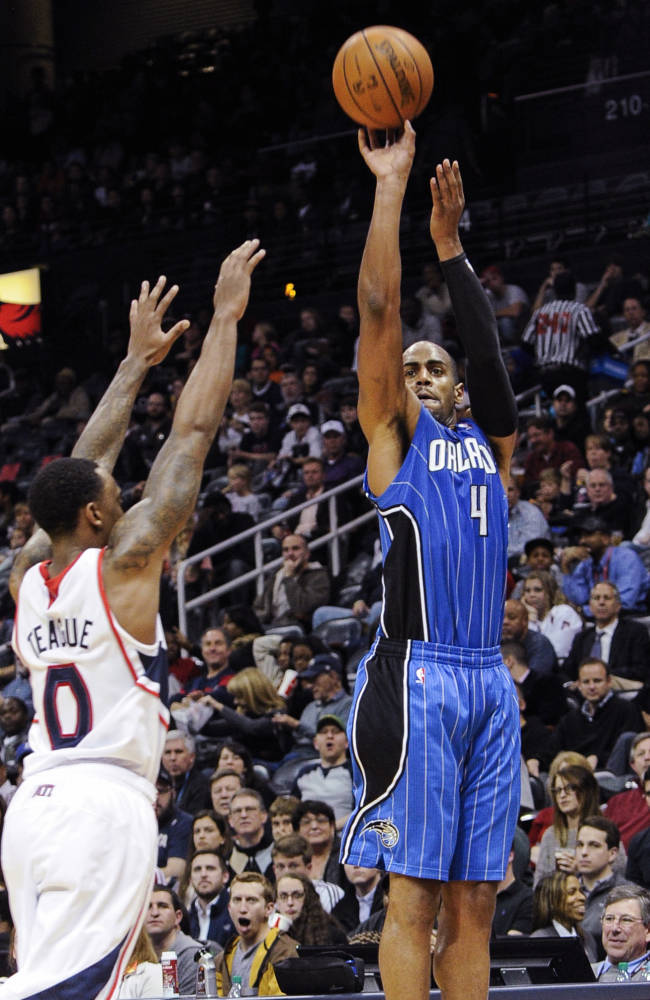 Orlando Magic guard Arron Afflalo (4) puts up a jumper as Atlanta Hawks point guard Jeff Teague (0) defends during the second half of an NBA basketball game on Tuesday, Nov. 26, 2013, in Atlanta. Orlando won 109-92