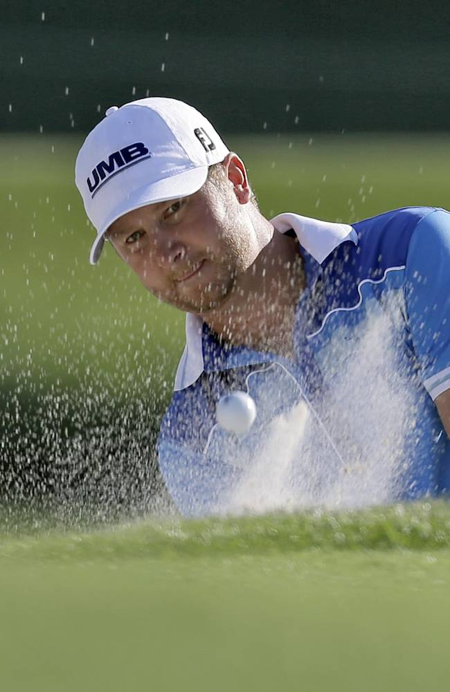 Brice Garnett blasts from a sand trap on the 17th hole during the first round of the Arnold Palmer Invitational golf tournament at Bay Hill Thursday, March 20, 2014, in Orlando, Fla