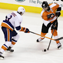 Philadelphia Flyers' Claude Giroux (28) moves the puck past New York Islanders' Travis Hamonic (3) in the third period of an NHL hockey game, Saturday, Nov. 23, 2013, in Philadelphia. Flyers won 5-2 The Associated Press