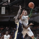 Miami's Shane Larkin (0) is fouled by Georgia Tech's Mfon Udofia during the first half of an NCAA college basketball game in Coral Gables, Fla., Wednesday, March 6, 2013. (AP Photo/Luis M. Alvarez)