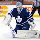 Toronto Maple Leafs goaltender Jonathan Bernier makes a save on the Calgary Flames during third period NHL action in Toronto on Tuesday April 1, 2014 The Associated Press
