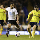Tottenham's Kyle Naughton, left, vies for the ball with Sunderland's Adam Johnson during the English Premier League soccer match between Tottenham Hotspur and Sunderland at White Hart Lane stadium in London, Monday, April 7, 2014