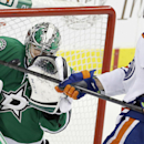 Edmonton Oilers left wing David Perron (57) tries to get the puck past Dallas Stars goalie Kari Lehtonen during the second period of an NHL hockey game Sunday, Dec. 1, 2013, in Dallas The Associated Press