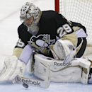 Pittsburgh Penguins goalie Marc-Andre Fleury (29) blocks a shot in the first overtime period of a first-round NHL playoff hockey game against the Columbus Blue Jackets in Pittsburgh, Saturday, April 19, 2014 The Associated Press