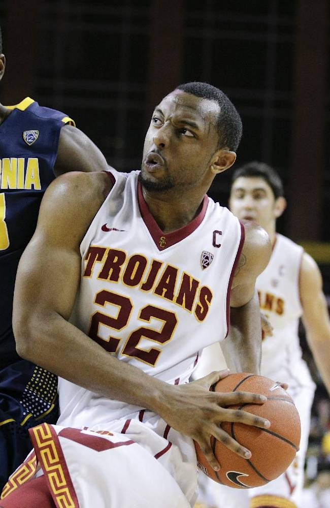 Southern California's Byron Wesley, center, drives to the basket against California's Jabari Bird during the second half of an NCAA college basketball game on Wednesday, Jan. 22, 2014, in Los Angeles. USC won 77-69