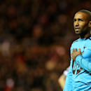 Tottenham Hotspurs' Jermain Defoe is seen wearing a black armband as a sign of respect to mark the life of former South African President Nelson Mandela, during their English Premier League soccer match against Sunderland at the Stadium of Light, Sunderla