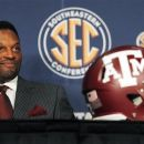 FILE - In this July 17, 2012, file photo, Texas A&M coach Kevin Sumlin smiles during a news conference at the NCAA college football Southeastern Conference media day in Hoover, Ala. This season, 28 of the 124 schools that play in the Football Bowl Subdivision will have a new man being held responsible for the program including Texas A&M, which lured rising star Sumlin away from Houston. (AP Photo/Butch Dill, File)