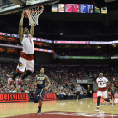 Louisville's Anton Gill, left, goes up for a dunk ahead of the defense of Florida International's Dominique Williams during the second half of an NCAA college basketball game Friday, Dec. 5, 2014, in Louisville, Ky. Louisville won 82-57. (AP Photo/Timothy D. Easley)