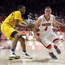 Arizona guard T.J. McConnell (4) drives on California guard Tyrone Wallace during the second half of an NCAA college basketball game, Thursday, March 5, 2015, in Tucson, Ariz. (AP Photo/Rick Scuteri)