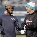 Former Ohio State players Chicago Bears wide receiver Santonio Holmes, left, and Miami Dolphins wide receiver Brian Hartline talk before an NFL football game Sunday, Oct. 19, 2014 in Chicago, The Associated Press