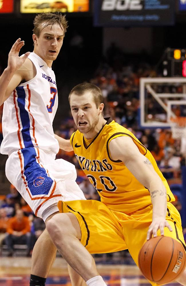 Wyoming's Nathan Sobey (20) moves the ball around Boise State's Anthony Drmic (3) during the second half of an NCAA college basketball game in Boise, Idaho, on Saturday, Jan. 11, 2014. Wyoming defeated Boise State 52-50