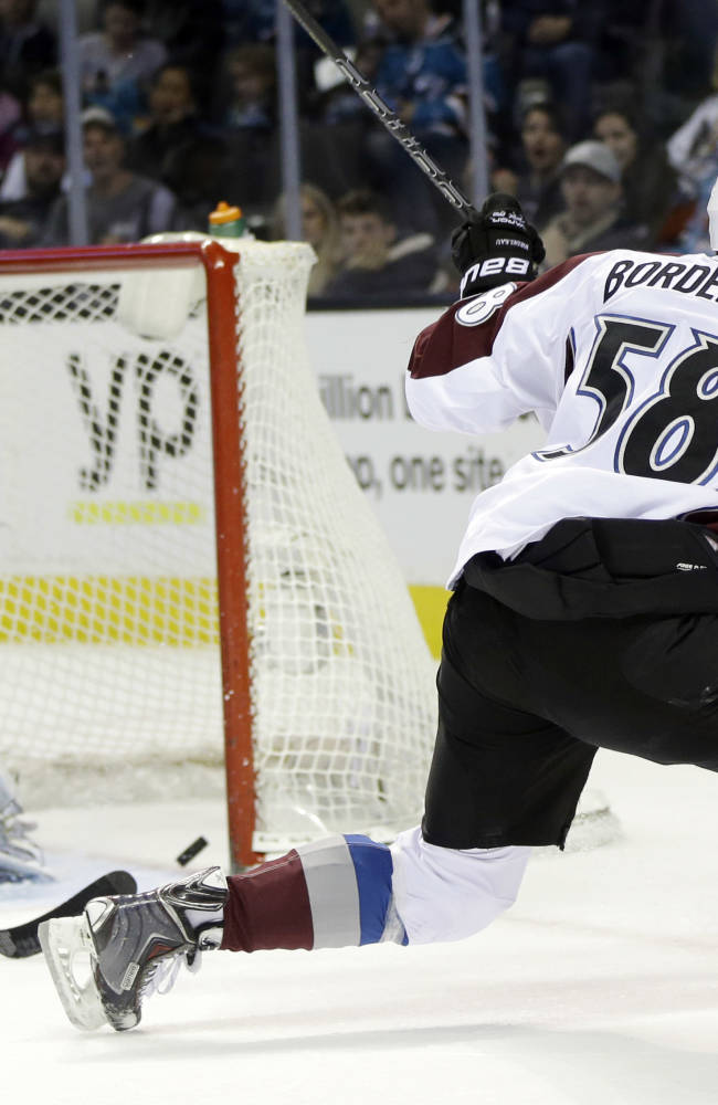 Colorado Avalanche's Patrick Bordeleau (58) scores past San Jose Sharks goalie Alex Stalock, left, during the second period of an NHL hockey game Friday, April 11, 2014, in San Jose, Calif