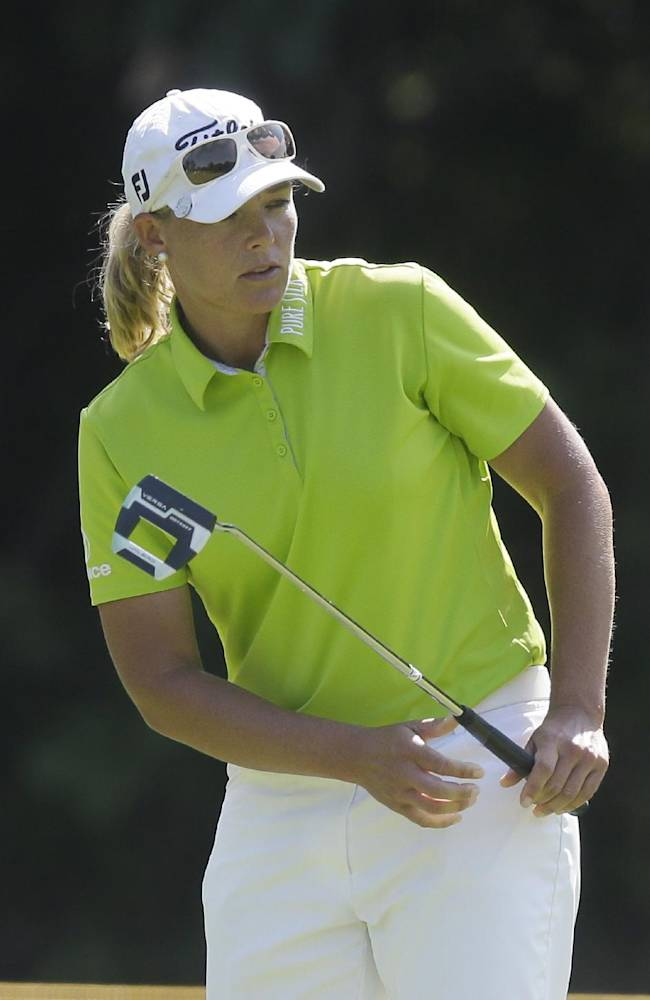 Katherine Kirk of Australia watches her putt on the 10th hole during the first round of the Meijer LPGA Classic golf tournament at Blythefield Country Club, Thursday, Aug. 7, 2014 in Belmont, Mich