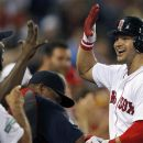 Boston Red Sox's Cody Ross, right, celebrates his three-run home run in the fourth inning of a baseball game against the Chicago White Sox in Boston, Wednesday, July 18, 2012. (AP Photo/Michael Dwyer)