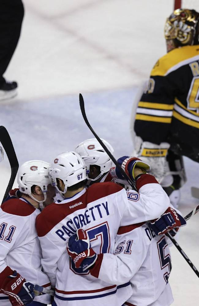 Montreal Canadiens left wing Max Pacioretty (67) is congratulated by teammates after his goal against Boston Bruins goalie Tuukka Rask (40) during the second period in Game 7 of a second-round NHL hockey Stanley Cup playoff series in Boston, Wednesday, May 14, 2014. (AP Photo)