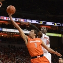 Syracuse's Michael Carter-Williams shoots a layup against Louisville's Gorgui Dioeng during the first half of an NCAA college basketball game Saturday, Jan. 19, 2013, in Louisville, Ky. (AP Photo/Timothy D. Easley)