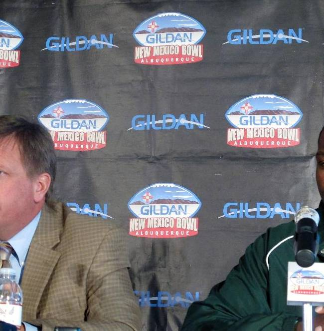 Colorado State head coach Jim McElwain, left, and lineman Shaquil Barrett speak to members of the media at the Isleta Resort & Casino in Isleta Pueblo, N.M., Friday, Dec. 20, 2013. Colorado State (7-6) will meet Washington State (6-6) in the New Mexico Bowl on Saturday in Albuquerque, N.M