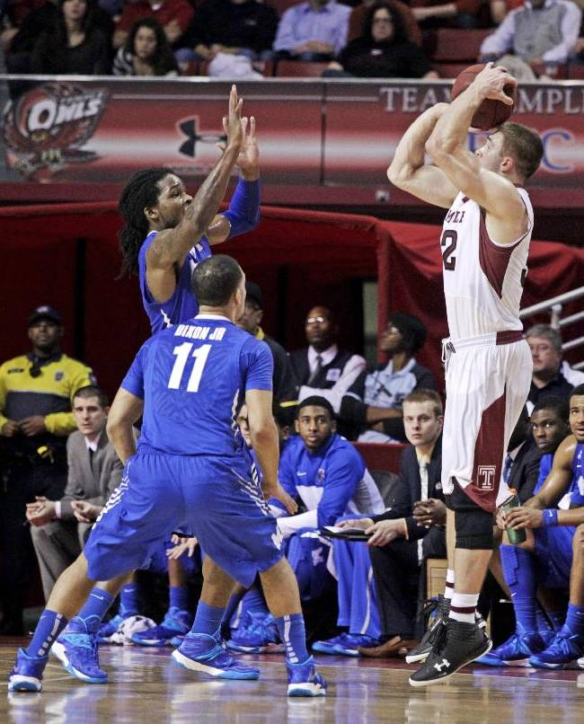 Memphis' Shaq Goodwin, and Michael Dixon Jr. (11) defend as Temple's Dalton Pepper, right, shoots a three in the first half of an NCAA basketball game, Saturday, Jan. 11, 2014, in Philadelphia