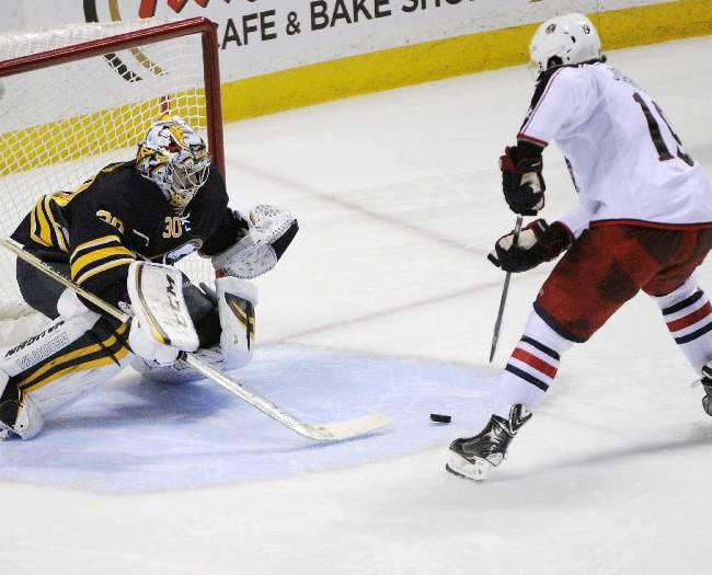 Buffalo Sabres goaltender Ryan Miller (30) tries to knock the puck from Columbus Blue Jackets center Ryan Johansen, right, as he scores the game-winning goal during the team shootout in an NHL hockey game in Buffalo, N.Y., Saturday, Jan.18, 2014. Columbus won 4-3