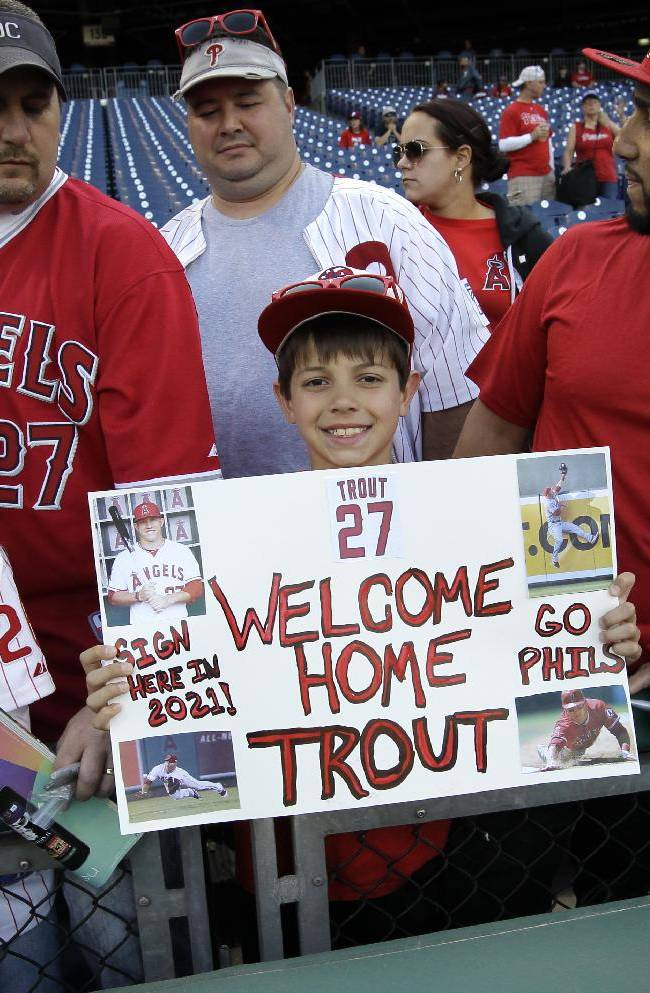 Justin Shephard, nine years old, from Deptford, N.J., holds up a sign for Los Angeles Angels' Mike Trout before the start of a baseball game with the Philadelphia Phillies, Tuesday, May 13, 2014, in Philadelphia