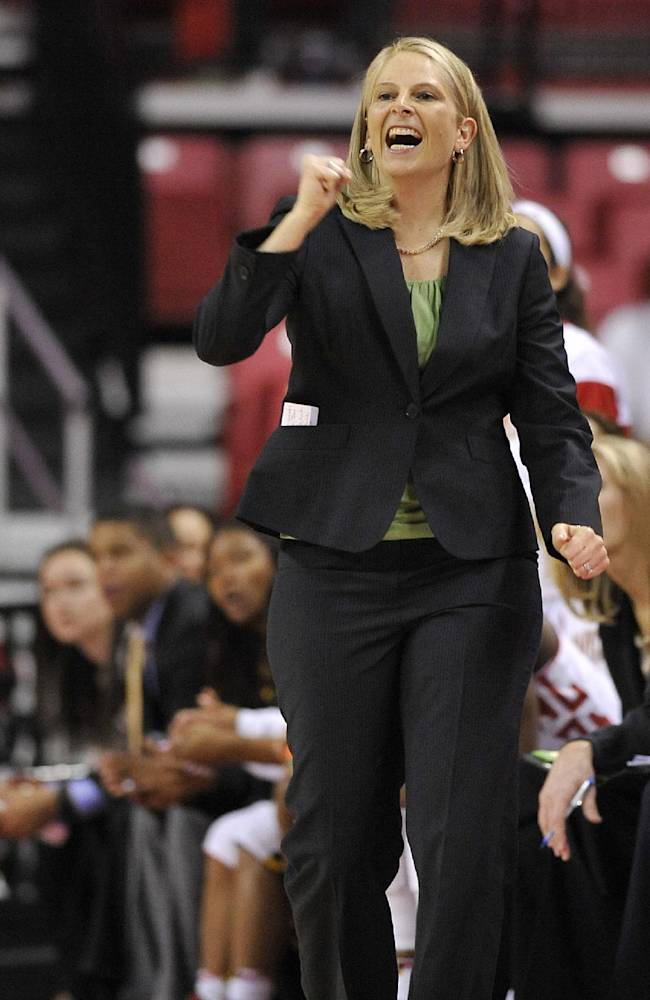 Maryland coach Brenda Frese cheers her team on against Wofford in the first half of an NCAA college basketball game Saturday, Dec. 28, 2013, in College Park, Md
