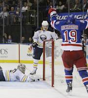 New York Rangers' Brad Richards (19) celebrates a goal by Chris Kreider (20) as Buffalo Sabres goalie Ryan Miller (30) gets up during the second period of an NHL hockey game Thursday, Oct. 31, 2013, in New York. (AP Photo/Frank Franklin II)
