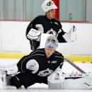 Colorado Avalanche goalies Semyon Varlamov, front, and Reto Berra stretch during the first day of NHL hockey training camp Thursday, Sept. 19, 2014, in Centennial, Colo The Associated Press