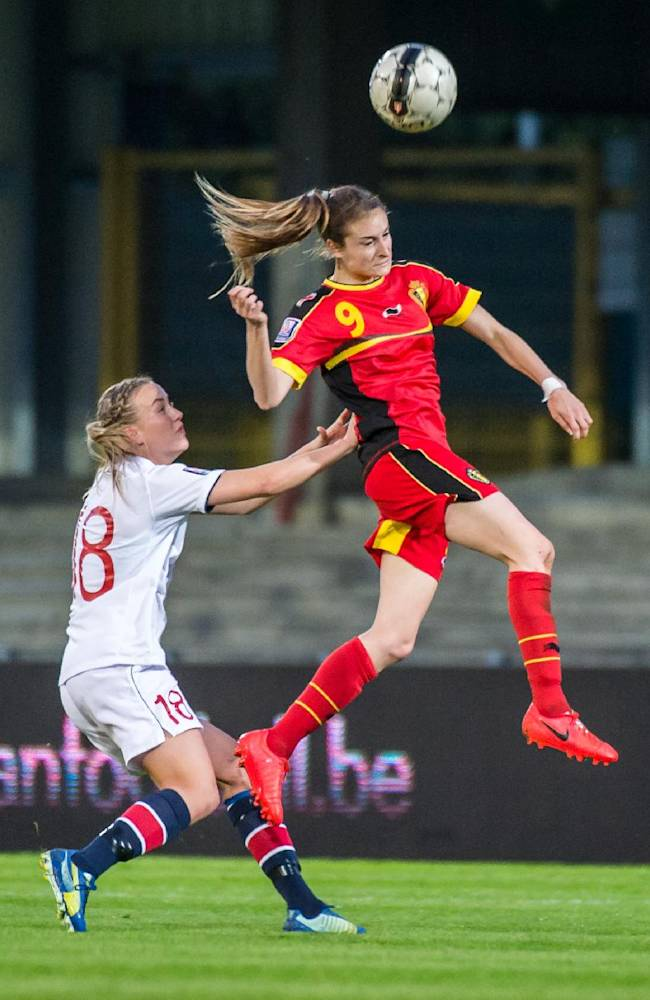 Belgium's Tessa Wullaert, right, challenges Norway's Kristine Minde during the Women's World Cup Group 5 qualifying match in Leuven, Belgium on Thursday April 10, 2014