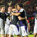 Liverpool's Steven Gerrard, centre left, celebrates scoring his penalty with team-mate Luis Suarez, during their English Premier League soccer match against Southampton, at St Mary's, Southampton, England, Saturday March 1, 2014