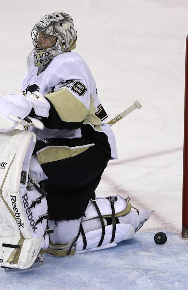 Pittsburgh Penguins goalie Marc-Andre Fleury (29) reacts after being scored against by New York Rangers left wing Carl Hagelin during the first period of Game 6 of a second-round NHL playoff hockey series on Sunday, May 11, 2014, in New York