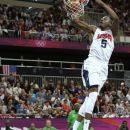 USA's Kevin Durant slams a dunk against Nigeria during a men's basketball game at the 2012 Summer Olympics, Thursday, Aug. 2, 2012, in London. (AP Photo/Charles Krupa)