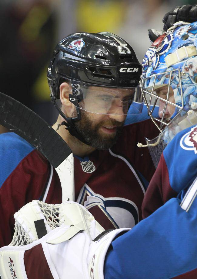 Colorado Avalanche center Maxime Talbot, left, congratulates goalie Semyon Varlamov, of Russia, after the Avalanche's 3-2 victory over the Chicago Blackhawks in an NHL hockey game in Denver on Wednesday, March 12, 2014