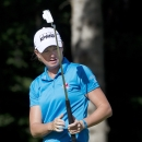 Stacy Lewis reacts to her putt during the first round of the Canadian Women's Open golf tournament in Edmonton, Alberta, Thursday, Aug. 22, 2013. (AP Photo/The Canadian Press, Jason Franson)