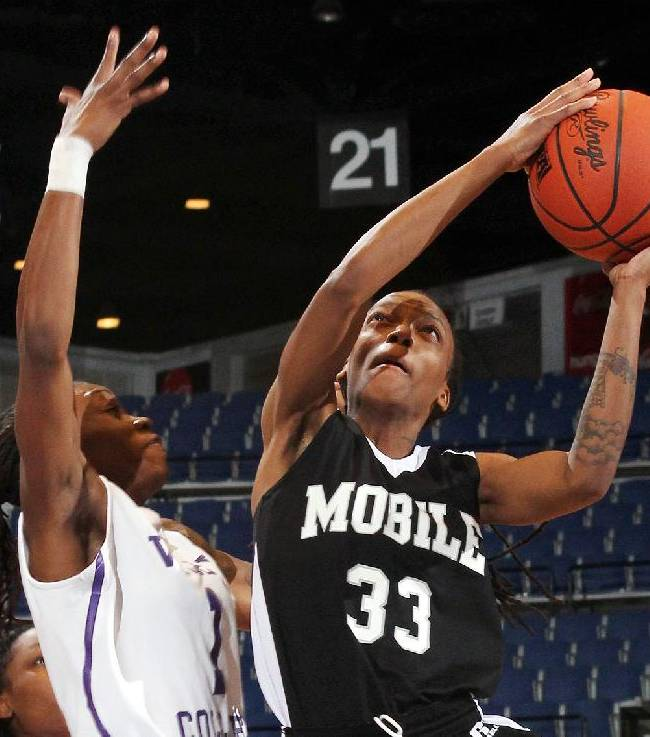 In this March 20, 2014 photo provided by the University of Mobile, Mobile's Deonica McCormick, right, goes to the basket as Wiley College's Danisha Shaw defends during an NCAA college basketball game in Mobile, Ala. McCormick was named the Alabama Sports Writers Association's Small College Athlete of the Year. The award is just another on a long list of superlatives for the Biloxi, Miss., native, a 5-foot-8 senior point guard. She was named first-team NAIA All-America, the league's Player of the Year and the SSAC tournament Most Valuable Player. McCormick was a WBCA All-America pick and one of three finalists for the WBCA NAIA National Player of the Year