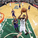 SALT LAKE CITY, UT - OCTOBER 24: Trevor Booker #33 of the Utah Jazz goes for a shot against the Phoenix Suns at EnergySolutions Arena on October 24, 2014 in Salt Lake City, Utah. (Photo by Melissa Majchrzak/NBAE via Getty Images)