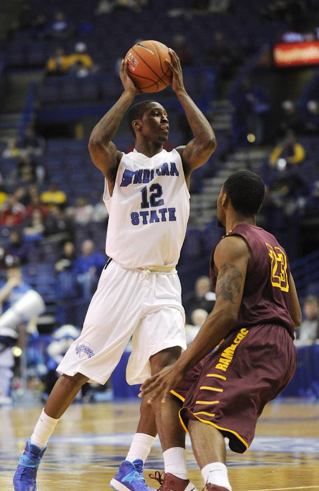 Indiana State's Dawon Cummings (12) looks to pass the ball away from Loyola of Chicago's Jeff White (23) during the first half of an NCAA college basketball game in the quarterfinals of the Missouri Valley Conference men's tournament, Friday, March 7, 2014, in St. Louis