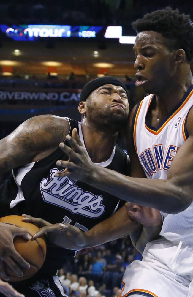 Sacramento Kings center DeMarcus Cousins (15) drives into Oklahoma City Thunder center Hasheem Thabeet during the first quarter of an NBA basketball game in Oklahoma City, Friday, March 28, 2014