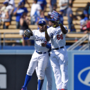 Los Angeles Dodgers' Carl Crawford, left, and Yasiel Puig, right, celebrate along with Matt Kemp after they defeated the Arizona Diamondbacks 4-1 in a baseball game, Sunday, April 20, 2014, in Los Angeles The Associated Press