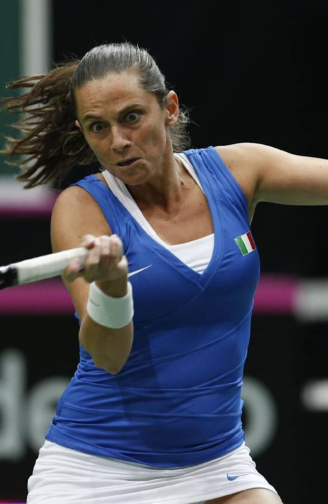 Italy's Roberta Vinci returns a ball to Czech Republic's Petra Kvitova during their Fed Cup semifinal tennis match in Ostrava, Czech Republic, Sunday, April 20, 2014