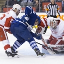 Detroit Red Wings goaltender Petr Mrazek (34) saves a shot from Toronto Maple Leafs' David Booth (20) as Detroit's Brian Lashoff (20) covers during second period of an NHL hockey game in Toronto, Saturday, Dec. 13, 2014 The Associated Press