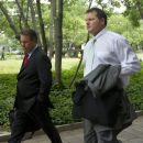 Former Major League Baseball pitcher Roger Clemens, right, arrives at federal court in Washington, Wednesday, May 23, 2012.  (AP Photo/Manuel Balce Ceneta)