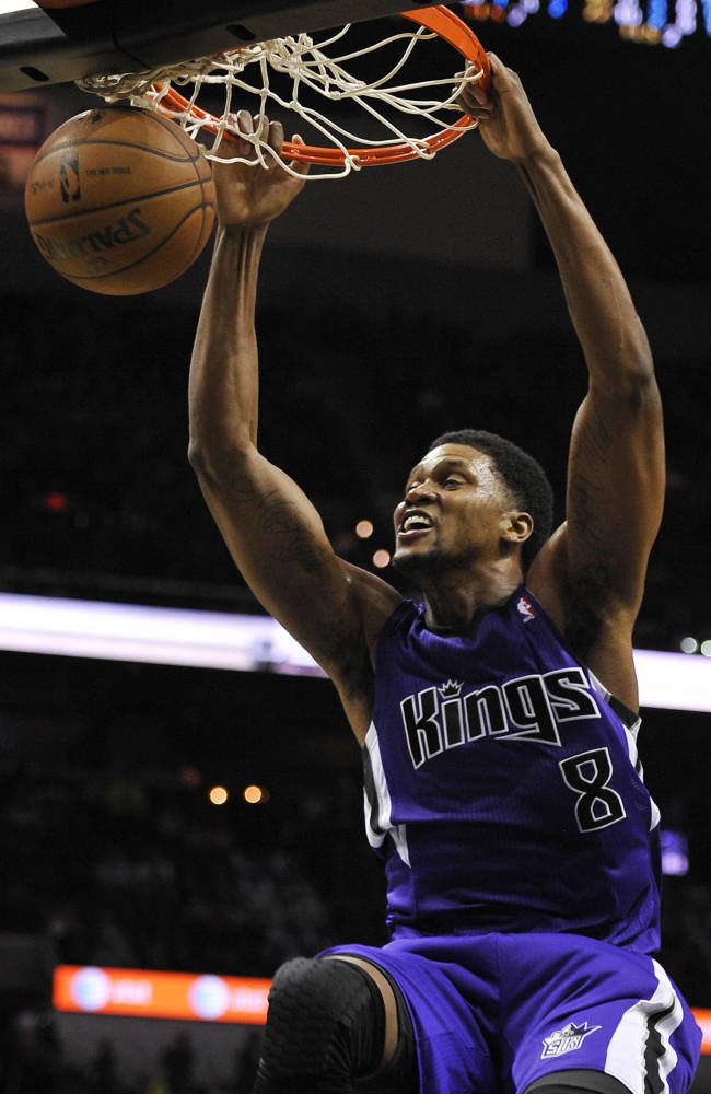 Sacramento Kings forward Rudy Gay dunks during the second half of an NBA basketball game against the San Antonio Spurs on Sunday, Dec. 29, 2013, in San Antonio. San Antonio won 112-104
