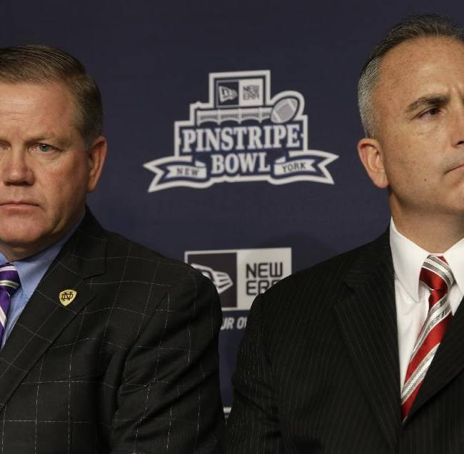Notre Dame coach Brian Kelly, left, and Rutger coach Kyle Flood attend an NCAA college football news conference in New York, Tuesday, Dec. 10, 2013. Rutgers and Notre Dame will face off at the Pinstripe Bowl at Yankee Stadium on Saturday, Dec. 28, 2013