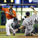 San Diego Padres' Seth Smith (12) is forced out at second base by Miami Marlins shortstop Adeiny Hechavarria in the third inning of a baseball game in Miami, Sunday, April 6, 2014. Chase Headley was safe at first base on a fielder's choice The Associated