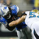 Jacksonville Jaguars linebacker Nate Stupar (54) tackles Detroit Lions running back Mikel Leshoure (25) in the second half of a preseason NFL football game at Ford Field in Detroit, Friday, Aug. 22, 2014 The Associated Press
